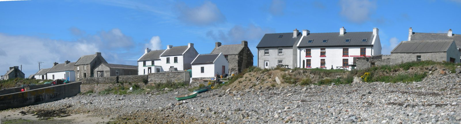 part of the main cluster of houses on Inishbofin which run along the shore by the pier