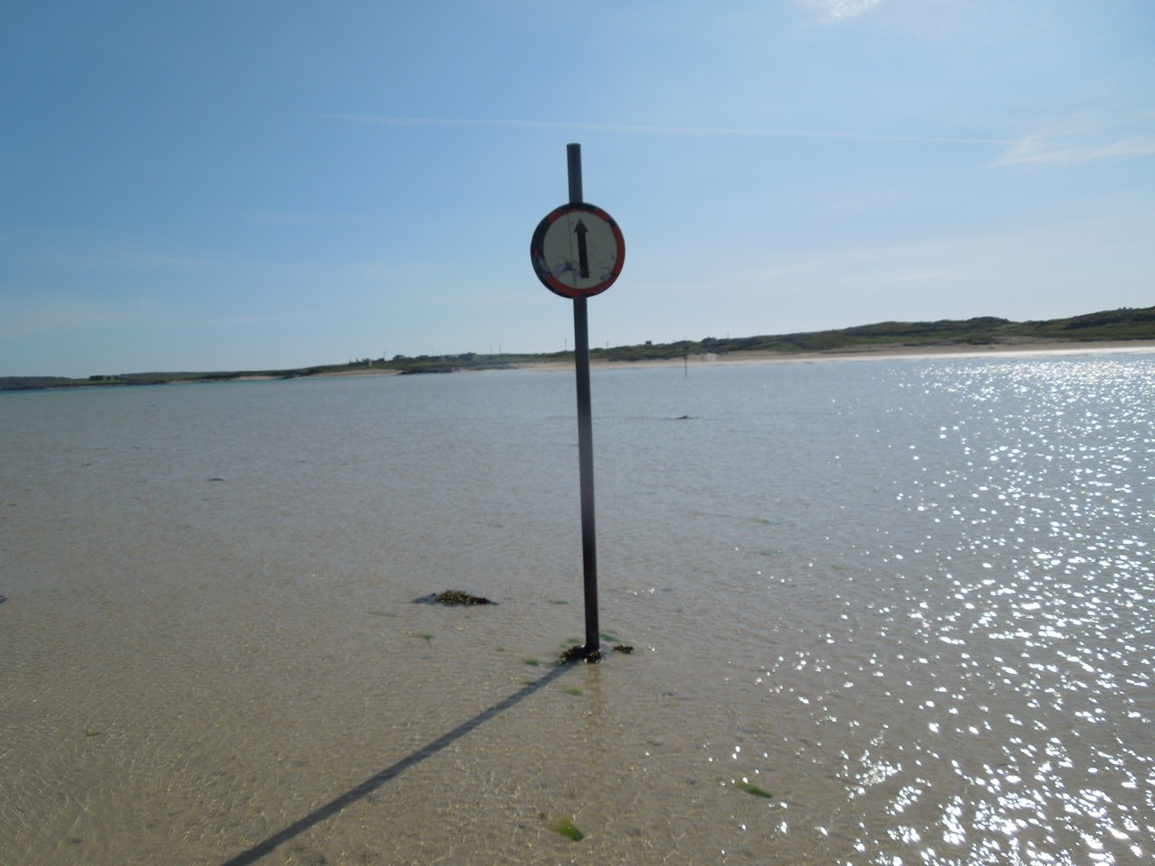 The 'road' to and from the island is clear at low tide.